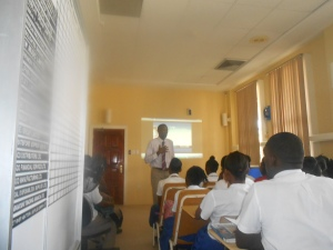 Michael Johnson Speaking to students about the Jamaica Stock Exchange