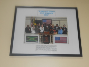 A picture of Prime Minister of Jamaica at the time with members of staff at the Jamaica Stock Exchange